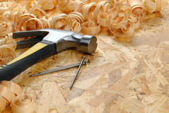 Hammer, nails, shavings Royalty Free Stock Image