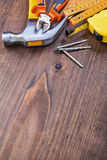 Hammer nails tapeline wooden meter nippers on Stock Photos