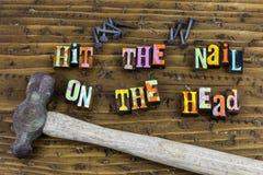 Hammer nails tools job craftsmanship. Typography letterpress message craft building hand made wood wooden stuff diy hit nail head stock photography