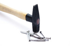 Hammer with nails. On white background Royalty Free Stock Photo