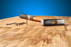 Hammer and nails on wood Royalty Free Stock Photo