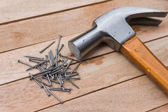 Hammer and nails on wood background Stock Images