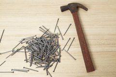 Hammer and nails on wood Royalty Free Stock Photos