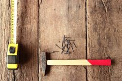 Hammer and nails on wood Royalty Free Stock Image