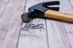 Hammer and nails on wood background Royalty Free Stock Photography