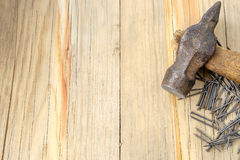 Hammer and nails on wood background Royalty Free Stock Photo