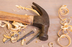 Hammer and nails on a wood board Stock Photos