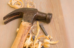 Hammer and nails on a wood board Royalty Free Stock Photos