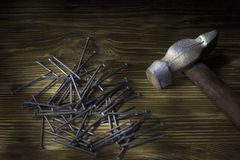 Hammer and nails on wood table Royalty Free Stock Photos