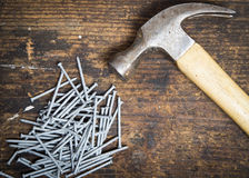 Hammer and nails. A hammer and nails on a wood workbench Royalty Free Stock Image