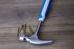 Hammer and nails. Hammer  and nails on a wooden background Royalty Free Stock Photos