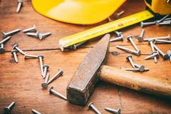 Hammer and nails on wooden background Stock Images
