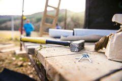 Hammer, nails on wooden boards outside on construction site Royalty Free Stock Images