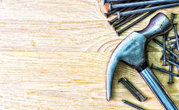 Hammer and nails on the wooden table. Royalty Free Stock Photo
