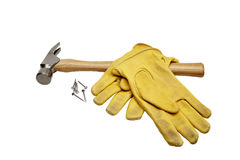 Hammer, nails and work gloves isolated on white Royalty Free Stock Images