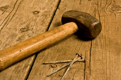 Hammer and nails on a workbench Royalty Free Stock Images