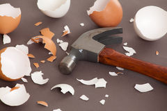 Hammer next to a bunch of cracked shells. Hammer next to a bunch of cracked egg shells Royalty Free Stock Image