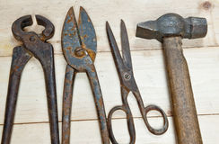 Hammer and nippers on wood background Stock Photography