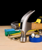 Hammer and other construction tools on wood Royalty Free Stock Photography