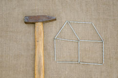 Hammer and outbuilding form of nail linen texture Stock Photos
