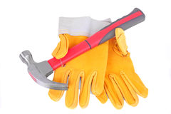 Hammer and pair of protective gloves. Hammer and pair of yellow protective gloves, isolated on white Royalty Free Stock Photography