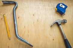 Hammer, pencil, nail catcher, tape measure Stock Photo