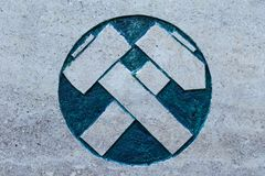 Hammer and pick on stone surface. Symbolizing the alliance of workers and peasants. Symbol of mining stock images