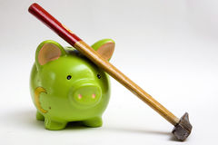 Hammer and piggy bank Royalty Free Stock Photos