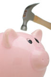 Hammer and Piggy Bank Stock Photo