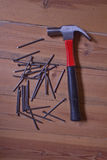 Hammer and a pile of nails Stock Photography