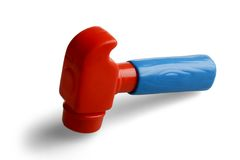 Hammer, a plastic toy. On white background Royalty Free Stock Photo