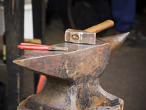 Hammer and pliers on anvil Royalty Free Stock Photos