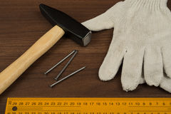 Hammer, protective gloves and ruler Royalty Free Stock Photography