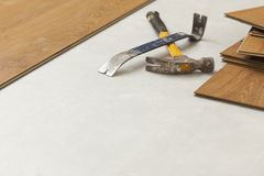 Hammer and Pry Bar with Laminate Flooring Abstract Royalty Free Stock Photo