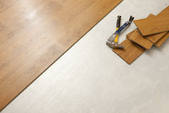 Hammer and Pry Bar with Laminate Flooring Abstract Stock Photography