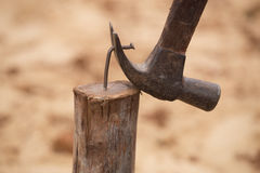 Hammer pulling a nail out of wood Stock Photos