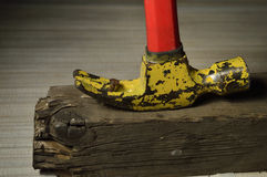 Hammer. Pulls out a nail with a hammer beam Royalty Free Stock Image