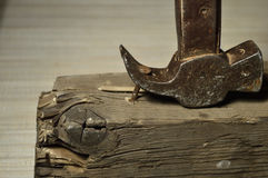 Hammer. Pulls out a nail with a hammer beam Royalty Free Stock Images