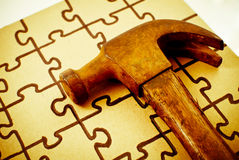 Hammer and Puzzle Royalty Free Stock Photos
