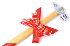 Hammer with red bow as a gift for handyman Royalty Free Stock Image