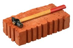 Hammer and red brick Stock Image