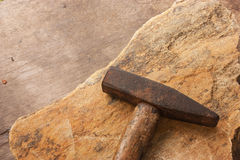 Hammer on the Rock Stock Photo
