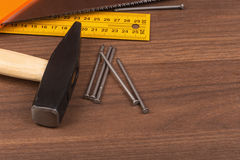 Hammer with ruler and documents on table Royalty Free Stock Photos
