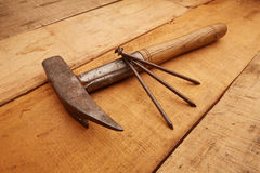 Hammer with rusty nails. Carpenter Tools on rustic wood royalty free stock photo