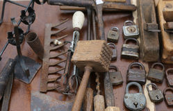 Hammer and rusty padlocks and planers in the workshop of flea ma Stock Photos