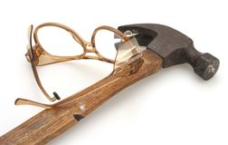 Hammer and Safety Glasses. Old vintage hammer and plastic protective safety glasses stock images