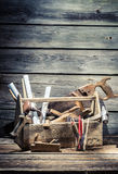 Hammer, saw and chisel in the carpentry toolbox Royalty Free Stock Images
