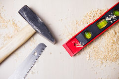 A hammer, a saw and a level Royalty Free Stock Images