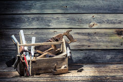 Hammer, saw and planer in the carpentry toolbox Royalty Free Stock Photo