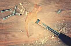 Hammer and sawdust and screws Royalty Free Stock Image